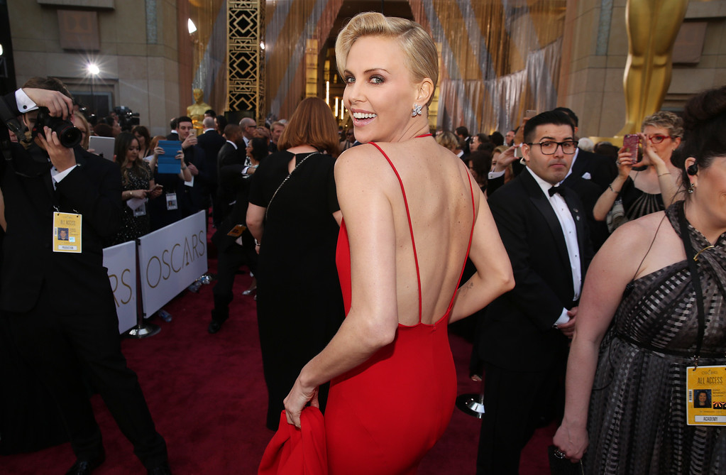 . Charlize Theron arrives at the Oscars on Sunday, Feb. 28, 2016, at the Dolby Theatre in Los Angeles. (Photo by Matt Sayles/Invision/AP)