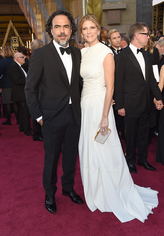 . Alejandro Gonzalez Inarritu, left, and Maria Eladia Hagerman arrive at the Oscars on Sunday, Feb. 28, 2016, at the Dolby Theatre in Los Angeles. (Photo by Richard Shotwell/Invision/AP)