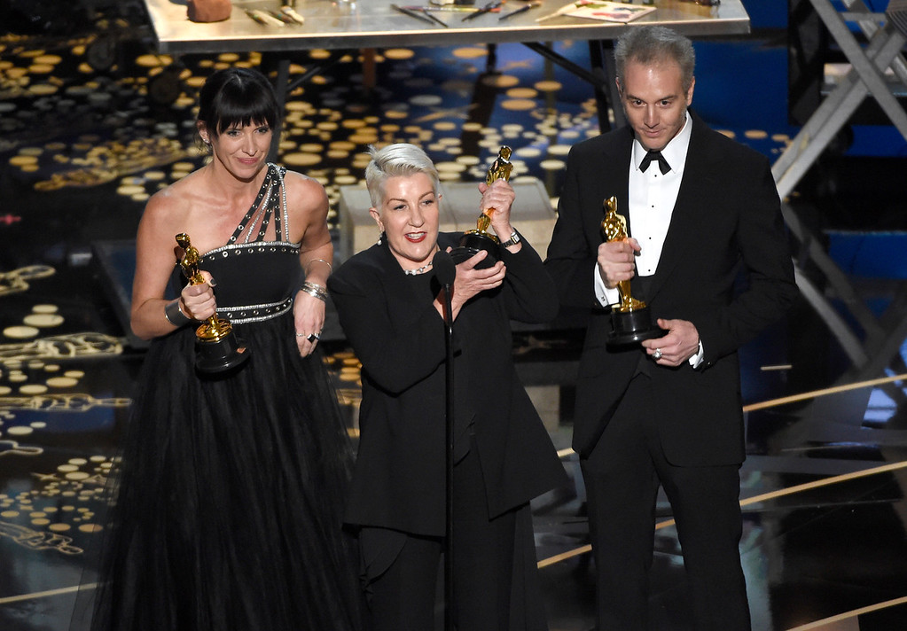 . Elka Wardega, from left, Lesley Vanderwalt, and Damian Martin accept the award for best makeup and hairstyling for �Mad Max: Fury Road� at the Oscars on Sunday, Feb. 28, 2016, at the Dolby Theatre in Los Angeles. (Photo by Chris Pizzello/Invision/AP)
