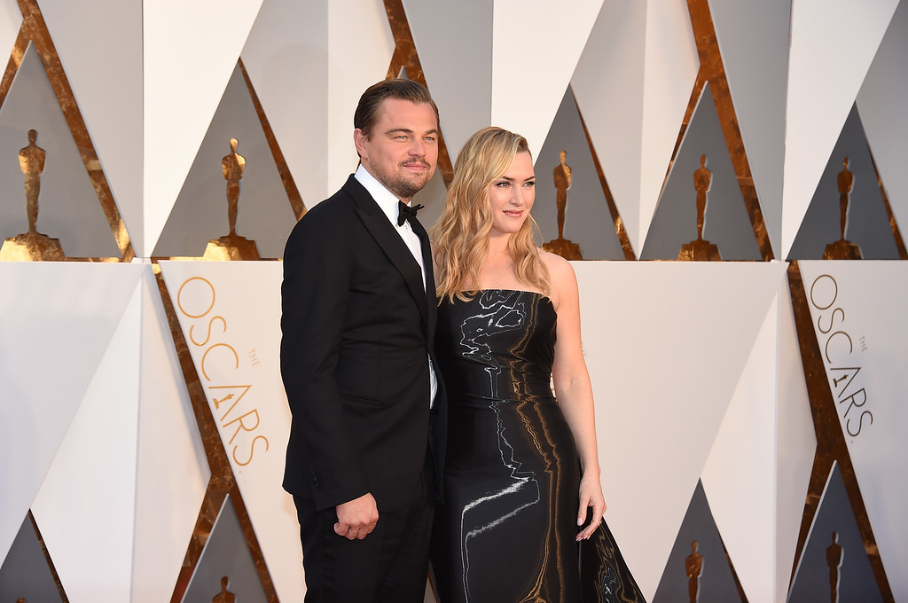 . Leonardo DiCaprio, left, and Kate Winslet arrive at the Oscars on Sunday, Feb. 28, 2016, at the Dolby Theatre in Los Angeles. (Photo by Jordan Strauss/Invision/AP)