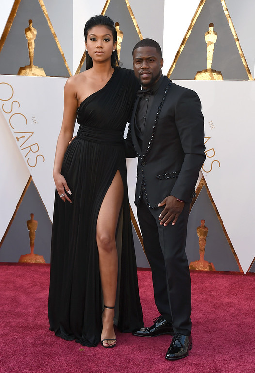 . Eniko Parrish, left, and Kevin Hart arrive at the Oscars on Sunday, Feb. 28, 2016, at the Dolby Theatre in Los Angeles. (Photo by Jordan Strauss/Invision/AP)
