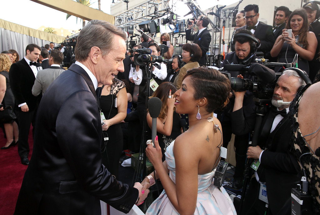 . Bryan Cranston, left, shakes hands with Alicia Quarles at the Oscars on Sunday, Feb. 28, 2016, at the Dolby Theatre in Los Angeles. (Photo by Matt Sayles/Invision/AP)