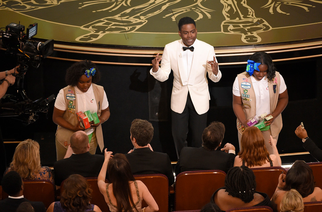 . Host Chris Rock sells Girl Scout cookies in the audience at the Oscars on Sunday, Feb. 28, 2016, at the Dolby Theatre in Los Angeles. (Photo by Chris Pizzello/Invision/AP)
