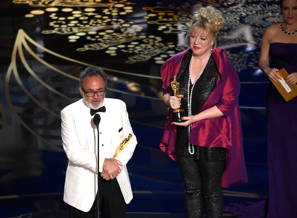 . Colin Gibson, left, and Lisa Thompson accept the award for best production design for �Mad Max: Fury Road� at the Oscars on Sunday, Feb. 28, 2016, at the Dolby Theatre in Los Angeles. (Photo by Chris Pizzello/Invision/AP)
