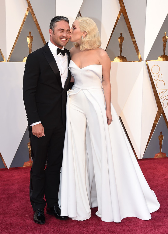 . Taylor Kinney, left, and Lady Gaga arrive at the Oscars on Sunday, Feb. 28, 2016, at the Dolby Theatre in Los Angeles. (Photo by Jordan Strauss/Invision/AP)