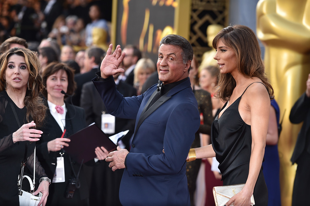 . Sylvester Stallone, left, and Jennifer Flavin arrive at the Oscars on Sunday, Feb. 28, 2016, at the Dolby Theatre in Los Angeles. (Photo by Jordan Strauss/Invision/AP)