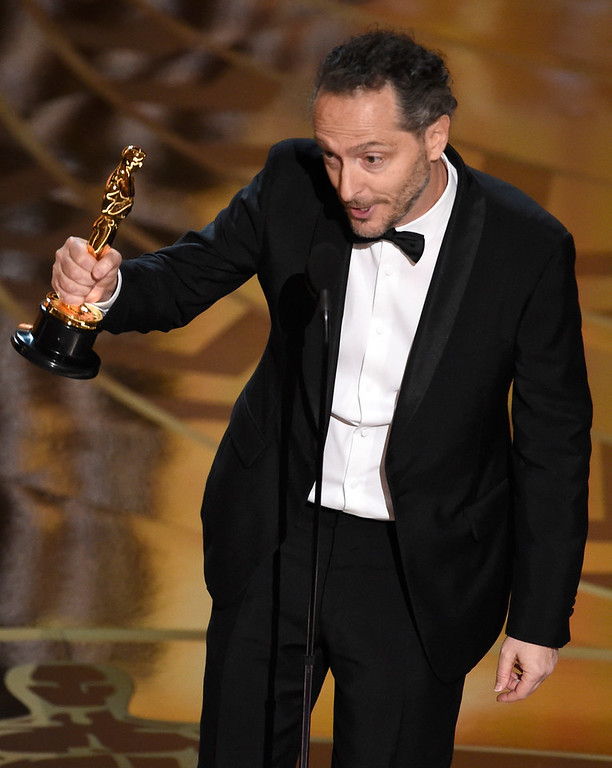 . Emmanuel Lubezki accepts the award for best cinematography for �The Revenant� at the Oscars on Sunday, Feb. 28, 2016, at the Dolby Theatre in Los Angeles. (Photo by Chris Pizzello/Invision/AP)