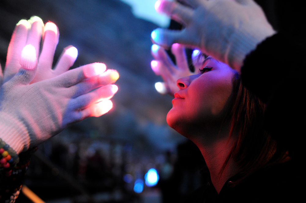 . Juleann Contreres, 18, of Boulder, Colorado gets a personal light show from a fellow concert goer as Pegboard Nerds performs during the Global Dub Festival at Red Rocks Amphitheatre on May 16, 2014 in Morrison, Colorado. (Photo by Seth McConnell/The Denver Post)