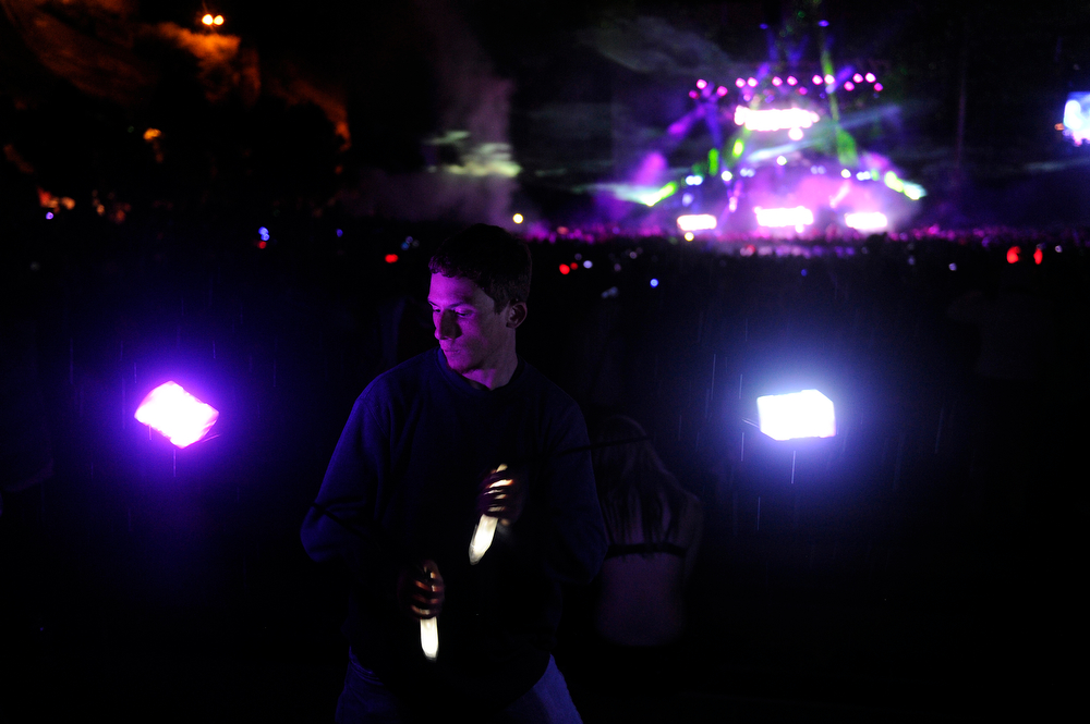 . Eric Reyes, 20, of Ft Collins, Colorado twirls a light on a string as he dances while Datsik performs during the Global Dub Festival at Red Rocks Amphitheatre on May 16, 2014 in Morrison, Colorado. (Photo by Seth McConnell/The Denver Post)
