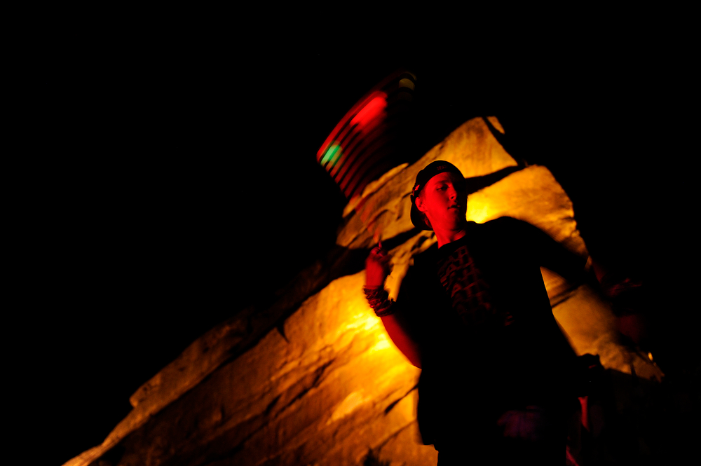 . Nick Tangsrud, 19, of Arvada, Colorado twirls a light on a string as he dances while Datsik performs during the Global Dub Festival at Red Rocks Amphitheatre on May 16, 2014 in Morrison, Colorado. (Photo by Seth McConnell/The Denver Post)