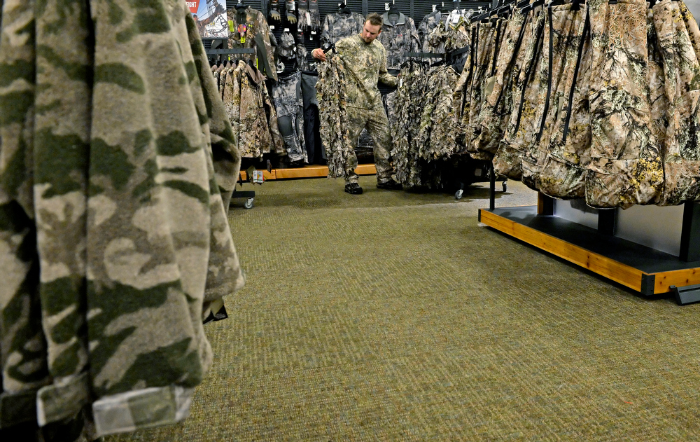 . Nathan Hall, an employee of Cabela\'s, helps set up the new store in Thornton, July 30, 2013. Cabela\'s held a media preview in advance of the opening of its two new stores in Thornton and Lone Tree on August 15. (Photo By RJ Sangosti/The Denver Post)