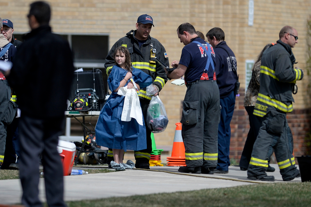 . LAKEWOOD, CO - APRIL 07: A student is dressed in a gown after being showered during an evacuation after students were exposed to hazardous skin irritants. Jeffco Open School evacuation on Monday, April 8, 2014. (Photo by AAron Ontiveroz/The Denver Post)