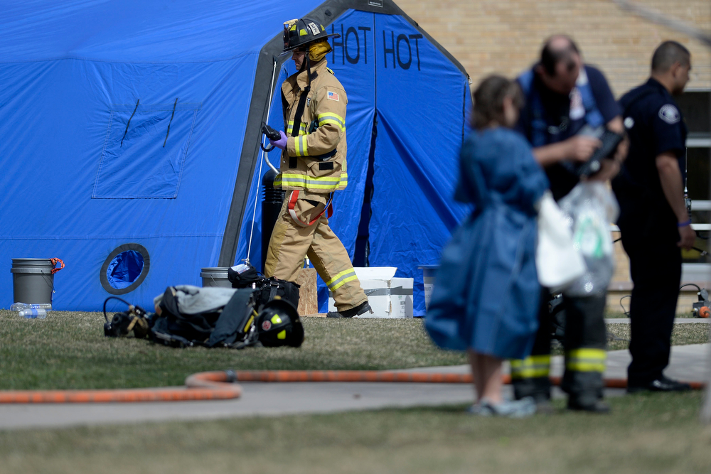 . LAKEWOOD, CO - APRIL 07: A firefighter works the scene during an evacuation after students were exposed to hazardous skin irritants. Jeffco Open School evacuation on Monday, April 8, 2014. (Photo by AAron Ontiveroz/The Denver Post)