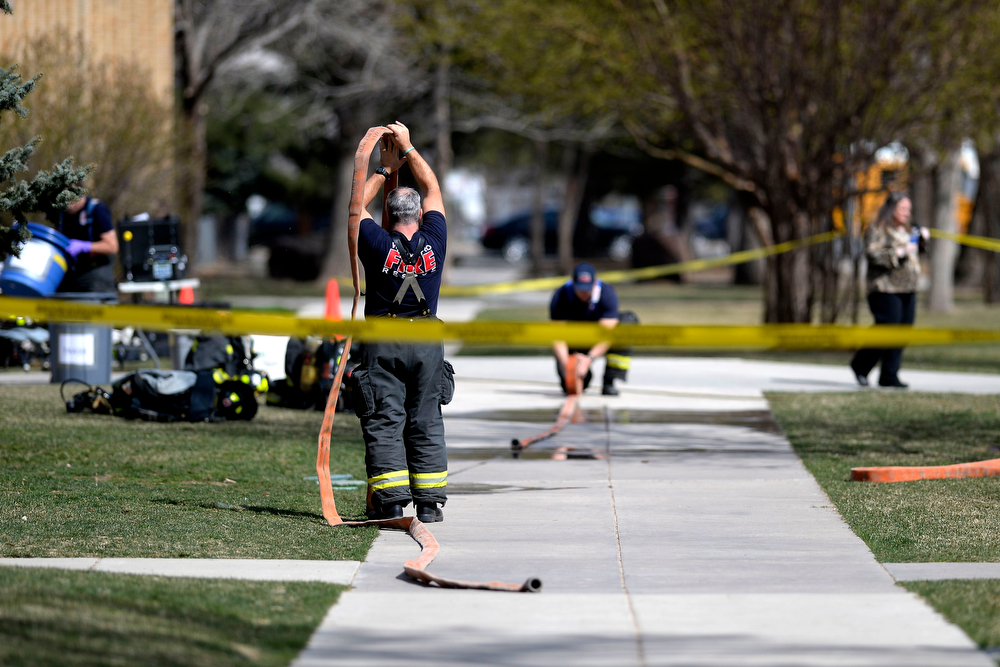 . LAKEWOOD, CO - APRIL 07: West Metro firefighters work the scene during an evacuation after students were exposed to hazardous skin irritants. Jeffco Open School evacuation on Monday, April 8, 2014. (Photo by AAron Ontiveroz/The Denver Post)