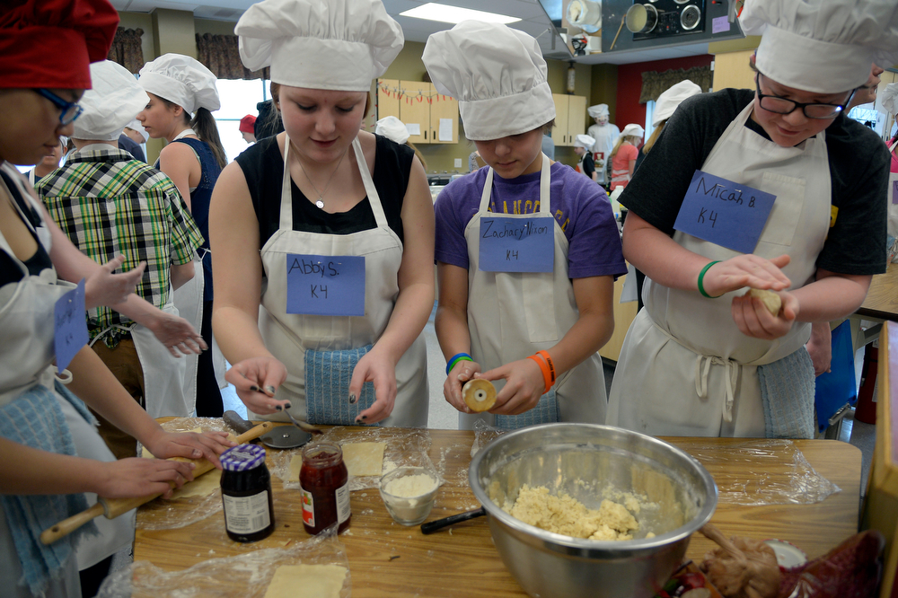 . Abby Seager, Zachary Mixon and Micah Babbitt work on their recipe during the Culinary Arts for Kidz cook off April 2, 2014 at Cresthill Middle School. (Photo by John Leyba/The Denver Post)