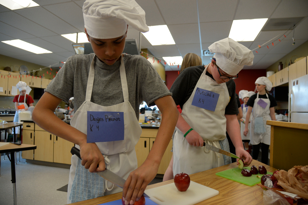 . Daylen Pleasant (L) and Micah Babbitt spice apples for their recipe during the Culinary Arts for Kidz cook off April 2, 2014 at Cresthill Middle School. (Photo by John Leyba/The Denver Post)