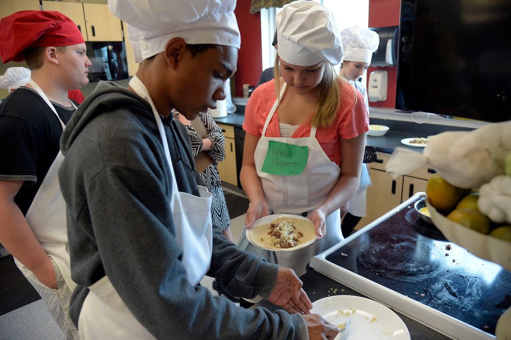 . Christian Harris (L) and Hannah Huppert prepare their food during the Culinary Arts for Kidz cook off April 2, 2014 at Cresthill Middle School. (Photo by John Leyba/The Denver Post)