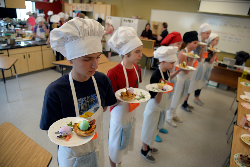 . Students prepare to present their dishes to the judges during the Culinary Arts for Kidz cook off April 2, 2014 at Cresthill Middle School. (Photo by John Leyba/The Denver Post)