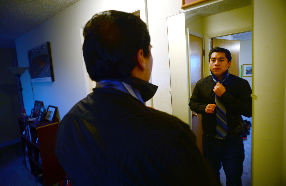 . Former foster care kid Diego Conde, 18, ties his tie before heading off for a busy day in Denver, on March 21, 2014.  (Photo By Helen H. Richardson/ The Denver Post)