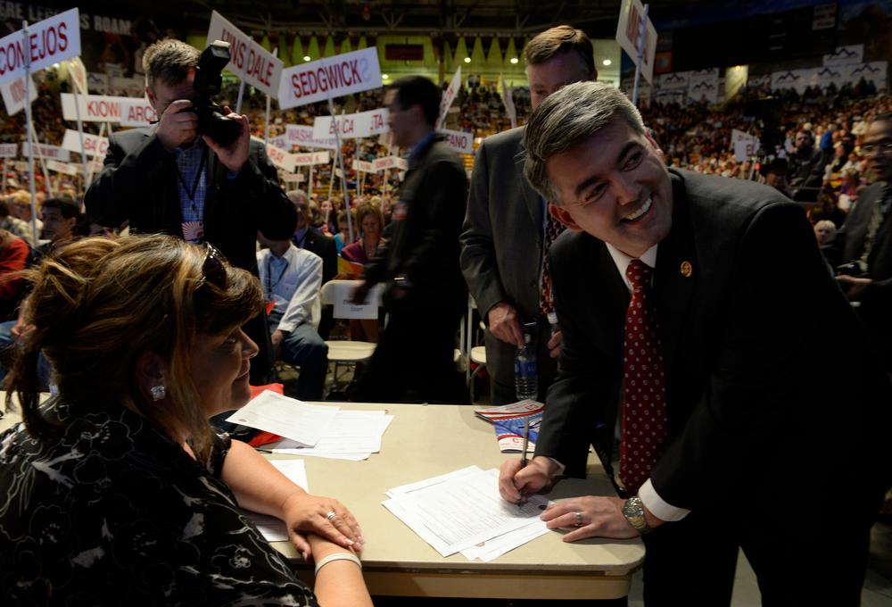. Lana Fore-Warkocz, secretary for the state Republican party, left, hands Congressman Cory Gardner, right, official paperwork to sign as he is accepted as a Republican candidate on the ballot for the United States Senate. The Colorado Republican Party holds its state assembly for statewide candidates running for office at the Coors Event Center on the University of Colorado campus in Boulder. (Kathryn Scott Osler, The Denver Post)