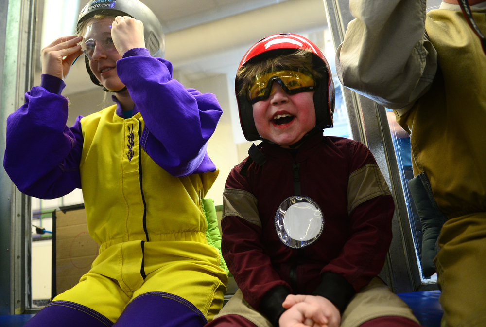 . Max Vertin, 7,  of Hastings, Nebraska, enjoys watching his brother flying through the air in the wind tunnel at SkyVenture Colorado indoor sky diving in Lone Tree, Co  on April 15, 2014 with his sister Lexi, 12, by his side. (Photo By Helen H. Richardson/ The Denver Post)