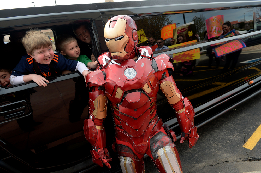 . Max Vertin, 8, second from left,  of Hastings, Nebraska, with his brother Rowen, 5, left gets a kick out of touching the costume of his idol superhero Iron Man while riding in a Humvee limousine outside of  SkyVenture Colorado indoor sky diving  in Lone Tree, Co  on April 15, 2014.  (Photo By Helen H. Richardson/ The Denver Post)