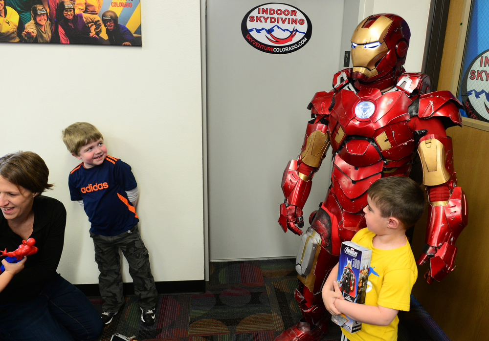 . Max Vertin, 8,  of Hastings, Nebraska, left, wearily looks at his idol Iron Man, right, who made a special appearance for Vertin at the  SkyVenture Colorado indoor sky diving in Lone Tree, Co  on April 15, 2014. (Photo By Helen H. Richardson/ The Denver Post)