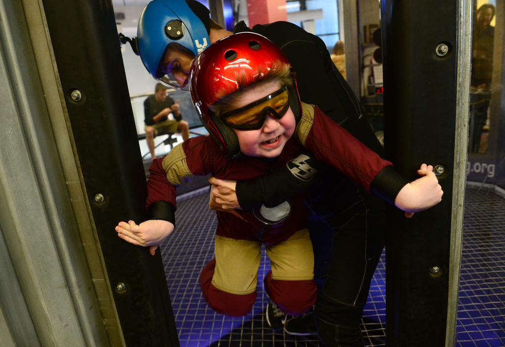 . Max Vertin, 8,  of Hastings, Nebraska, grabs the sides of the wind tunnel after finishing  flying through the air at SkyVenture Colorado indoor sky diving with the help of instructor Josh Evans in Lone Tree, Co  on April 15, 2014. (Photo By Helen H. Richardson/ The Denver Post)