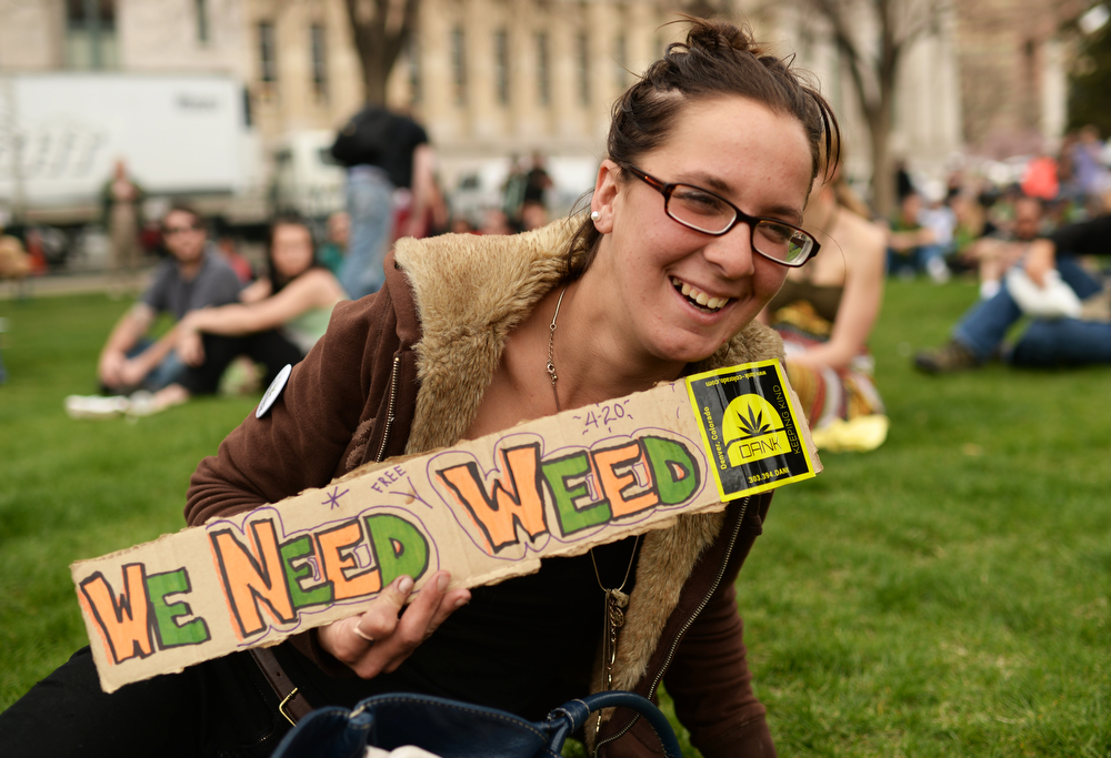. Daniela Ralph from Ohio is celebrating during the first day of the 420 Rally weekend in Civic Center Park, Denver, Colorado, April 19, 2014.  (Photo by Hyoung Chang/The Denver Post)