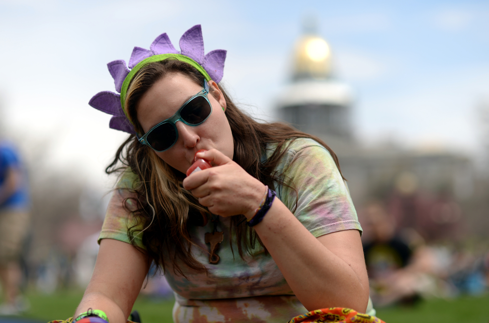 . Robin Goldfarb from Flagstone, TX is smoking marijuana during the first day of the 420 Rally weekend in Civic Center Park, Denver, Colorado, April 19, 2014. (Photo by Hyoung Chang/The Denver Post)