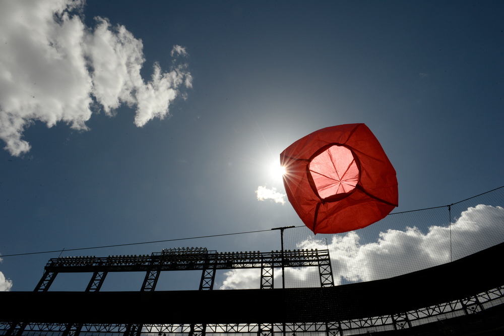 . Colorado State University�s Little Shop of Physics attempt to set a Guinness World Record for the largest physics lesson during the fifth annual Weather and Science Day at Coors Field, April 23, 2014. Little Shop staff full red bags with warm air to make them rise into the air during a interactive science lesson. (Photo by RJ Sangosti/The Denver Post)