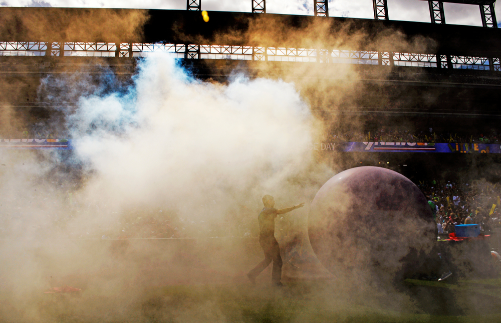 . Colorado State University�s Little Shop of Physics attempt to set a Guinness World Record for the largest physics lesson during the fifth annual Weather and Science Day at Coors Field, April 23, 2014. Zach Dickerson, CSU student volunteers during an interactive science lesson at Coors Field. Dickerson holds a balloon full of smoke. (Photo by RJ Sangosti/The Denver Post)