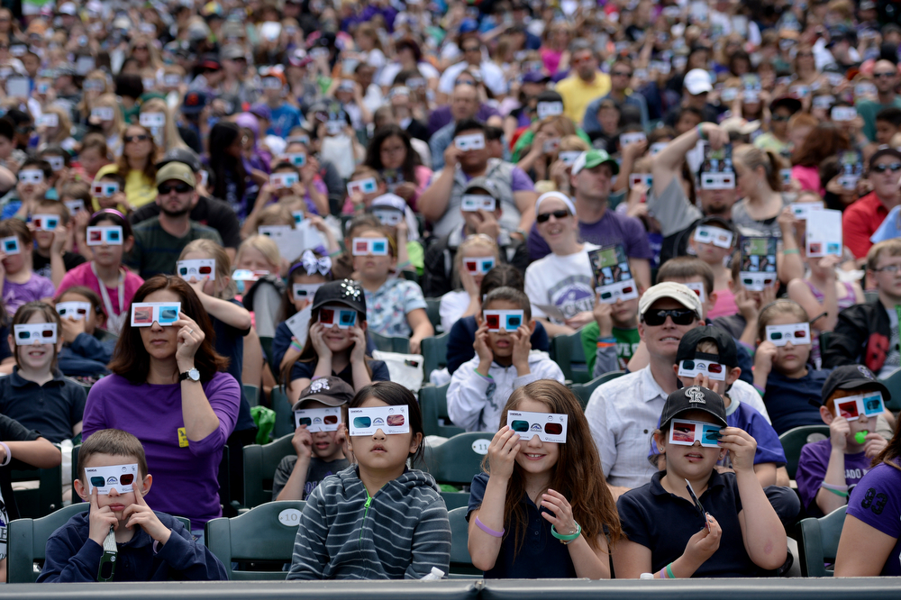 . Colorado State University�s Little Shop of Physics attempt to set a Guinness World Record for the largest physics lesson during the fifth annual Weather and Science Day at Coors Field, April 23, 2014. Over 10,000 students watch the big screen at Coors Field using special glass during an interactive science lesson. (Photo by RJ Sangosti/The Denver Post)