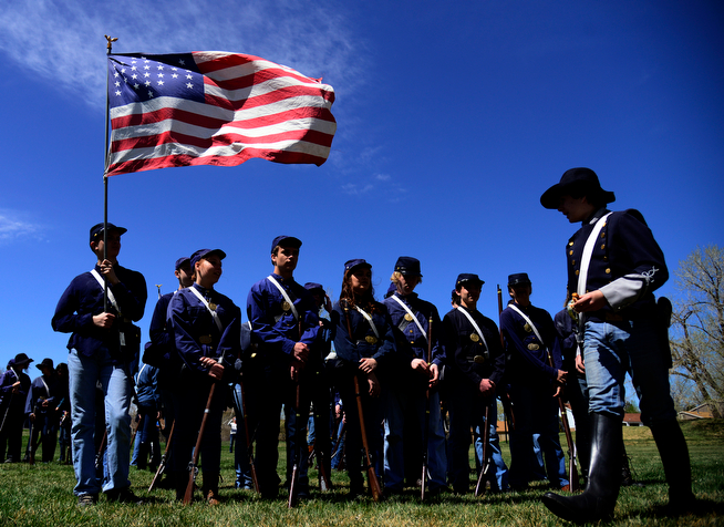 . Jonathan Perry, front right, plays a commander with the Union army as 400 eighth-grade students from Adams 12 School District reenact scenes from the Battle of Spotsylvania and the Battle of Cold Harbor during Century Middle School\'s annual Civil War Reenactment at Lake Village Park in Thornton on Thursday, April 24, 2014. �You Can Live History,� a Colorado-based nonprofit, provided authentic uniforms and weaponry and filmed the battles. (Photo By Lindsay Pierce/The Denver Post)
