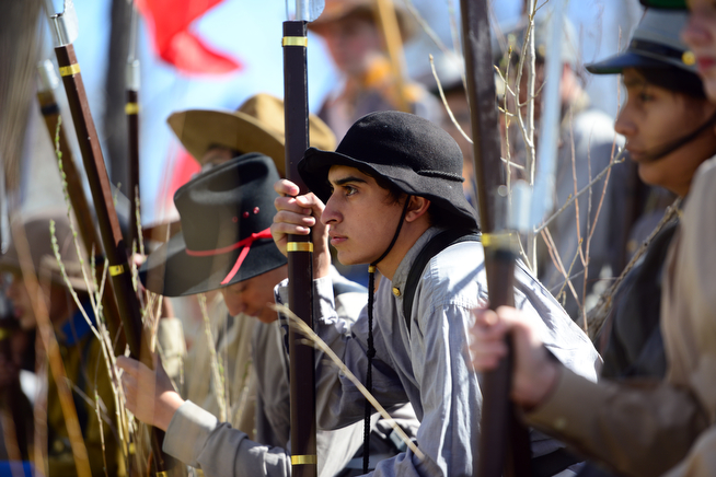 . Alex Perea, center, plays a confederate soldier waiting for battle, as 400 eighth-grade students from the Adams 12 School District reenact scenes from the Battle of Spotsylvania and the Battle of Cold Harbor during Century Middle School\'s annual Civil War Reenactment at Lake Village Park in Thornton on Thursday, April 24, 2014. �You Can Live History,� a Colorado-based nonprofit, provided authentic uniforms and weaponry and filmed the battles. (Photo By Lindsay Pierce/The Denver Post)