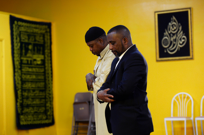 . Billy Wheelock, prays at the Northeast Denver Islamic Centeralogside an assistant Imam before his wedding ceremony Saturday, April 19, 2014. On Thursday April 17, 2014, Billy Wheelock became a free man after serving 21-years of a life sentence on drug charges, thanks to President Obama, who granted Wheelock clemency December 19, 2013. (Photo By Andy Cross / The Denver Post)