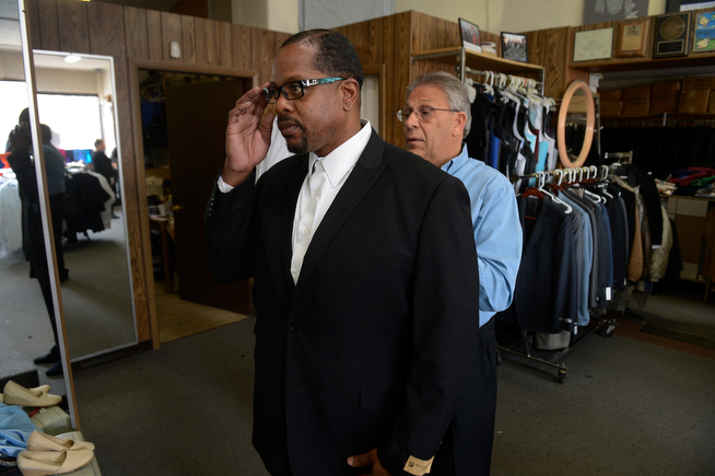 . Billy Wheelock, left, gets a suit tailored by Steve Duman at Duman\'s Tailor Shop and Uniform Company along E. Colfax Tuesday morning, April 15, 2014. Wheelock had a long checklist of things to take care of before his release from a Denver halfway house later in the week. President Obama granted clemency to Wheelock December 19, 2013 after serving 21-years of a life sentence for drug charges that occurred in Texas. On that list was getting married to his fiancee at the end of the week.  (Photo By Andy Cross / The Denver Post)