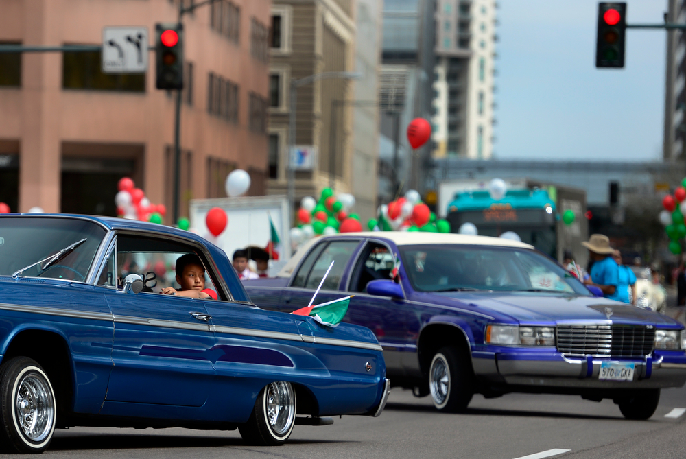 """. Members of the Rocky Mountain Cruisers make their way down Lincoln Street in front of the state capitol. The 27th Annual Cinco de Mayo Festival kicks off with the \""""Celebrate Culture\"""" parade winding through downtown Denver and ending at the festival site in Civic Center Park. The event includes a green chile bowl cook off, a taco eating contest, chihuahua races, as well as cultural foods and musical and dance performances running through Sunday. (Kathryn Scott Osler, The Denver Post)"""