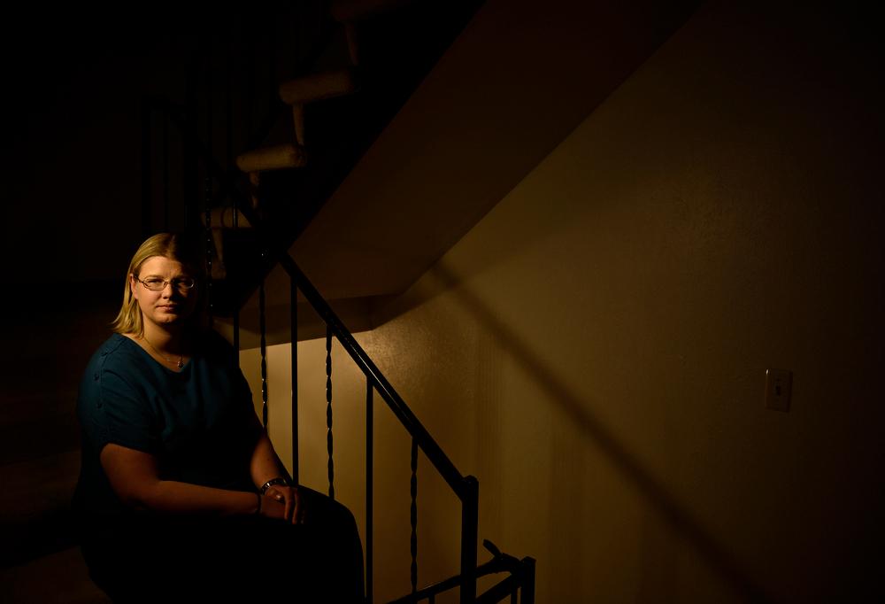 . Former Columbine High School student Erin Hernandez, at her home in Littleton, credits Frank DeAngelis, Columbine principal, with saving her life, April 29, 2014. Hernandez is now a teacher. (Photo by RJ Sangosti/The Denver Post)