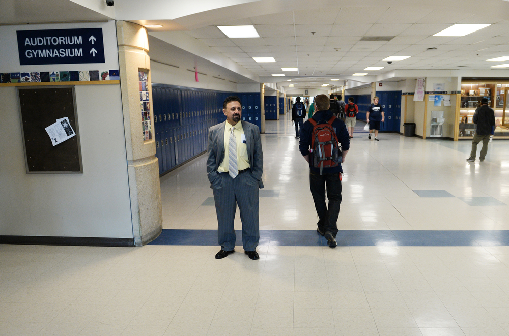 . Columbine High School Principal Frank DeAngelis watches as students make their way to class, Wednesday, April 16, 2014. DeAngelis plans to retire at the end of the school year. (Photo by RJ Sangosti/The Denver Post)