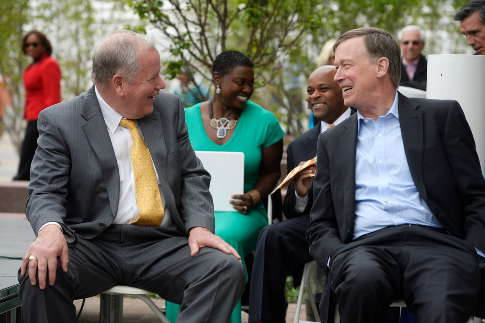 . Chuck Sisk, RTD Board Chair, left, and Colorado Governor, John Hickenlooper, right, have a laugh together during grand opening ceremonies for the new RTD Union Station Transit Center Friday morning, May 09, 2014. (Photo By Andy Cross / The Denver Post)