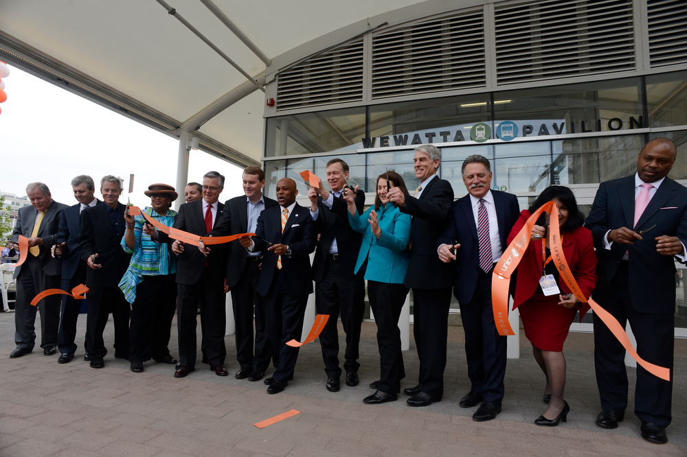 . Ribbon-cutting ceremony in front of the Wewatta Pavilion entrance officially opening the new RTD Union Station Transit Center Friday morning, May 09, 2014. (Photo By Andy Cross / The Denver Post)