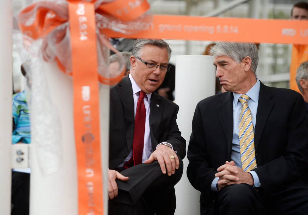 . Federal Railroad Administrator, Joseph Szabo, left, talks with U.S. Senator Mark Udall, during grand opening ceremonies for the Union Station Transit Center Friday morning, May 09, 2014. Szabo stepped in for U.S. Secretary of Transportation, Anthony Foxx, who couldn\'t make it out to Colorado due to mechanical problems on two flights to get here. (Photo By Andy Cross / The Denver Post)