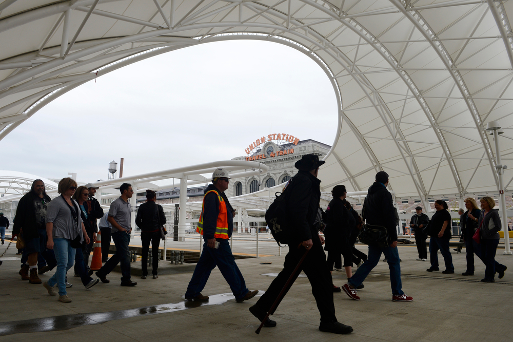 . The general public gets a first-hand look at the RTD Train Hall during the grand opening of the new RTD Union Station Transit Center Friday morning, May 09, 2014. (Photo By Andy Cross / The Denver Post)