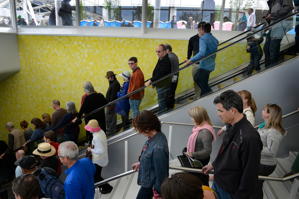 . The general public makes their way down to new RTD underground bus concourse for the first time from the Wewatta Pavilion entrance during the grand opening of the Union Station Transit Center Friday morning, May 09, 2014. (Photo By Andy Cross / The Denver Post)