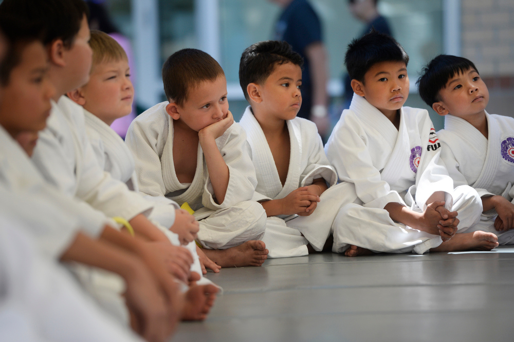 . Young Denver Buddhist Temple Judo Dojo members wait their turn on stage to perform at the annual Cherry Blossom Festival at the Sakura Square Saturday afternoon, June 28, 2014. The festival, which runs through Sunday 11-4 pm, showcases the Japanese American Culture that includes traditional dances, music, various demonstrations, and food. (Photo By Andy Cross / The Denver Post)