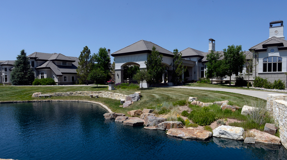 . The Serenity Ridge mansion, owned by former Dollar General CEO  Cal Turner Jr., in Douglas County, Colorado is on the housing market for $18.37 million.  The 11 bedroom, 24 bathroom home has over 50,000 square feet. It was photographed on Wednesday, July 2, 2014. Furnishings and artwork are included. There is pond out in front of the main entry to the front of  home.  (Denver Post Photo by Cyrus McCrimmon)