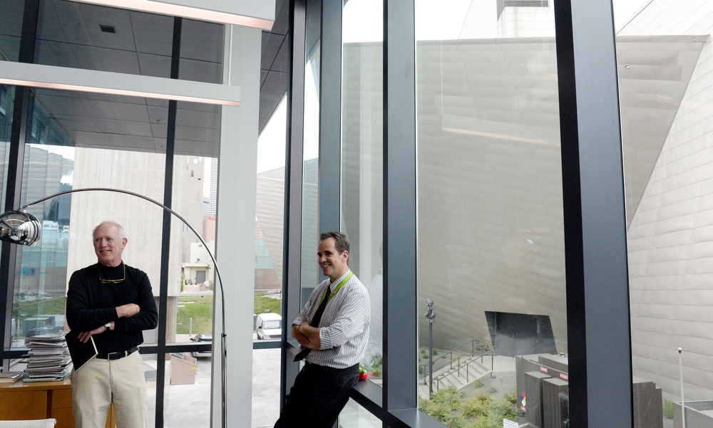 . Denver Art Museum is seen out the windows of director Christoph Heinrich\'s office space  at new administrative building for the museum on Thursday, June 26, 2014.  Jeff Shepard, left, was the architect for the project.  (Denver Post Photo by Cyrus McCrimmon)