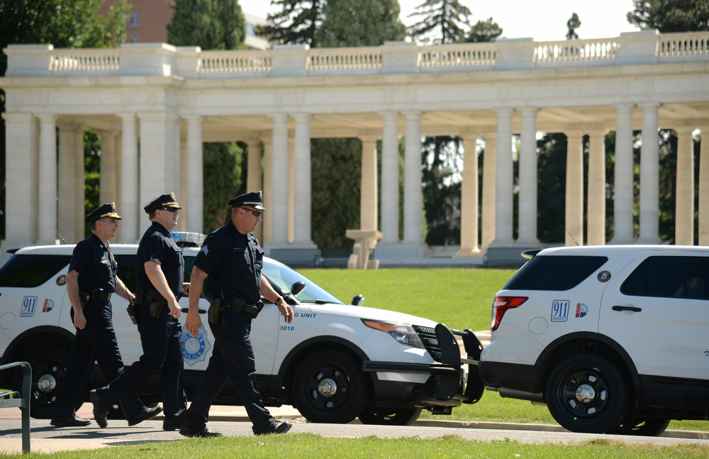 . Police officers secure the Cheesman Park for President Obama\'s economic speech. Denver, Colorado. July 09. 2014. (Photo by Hyoung Chang/The Denver Post)