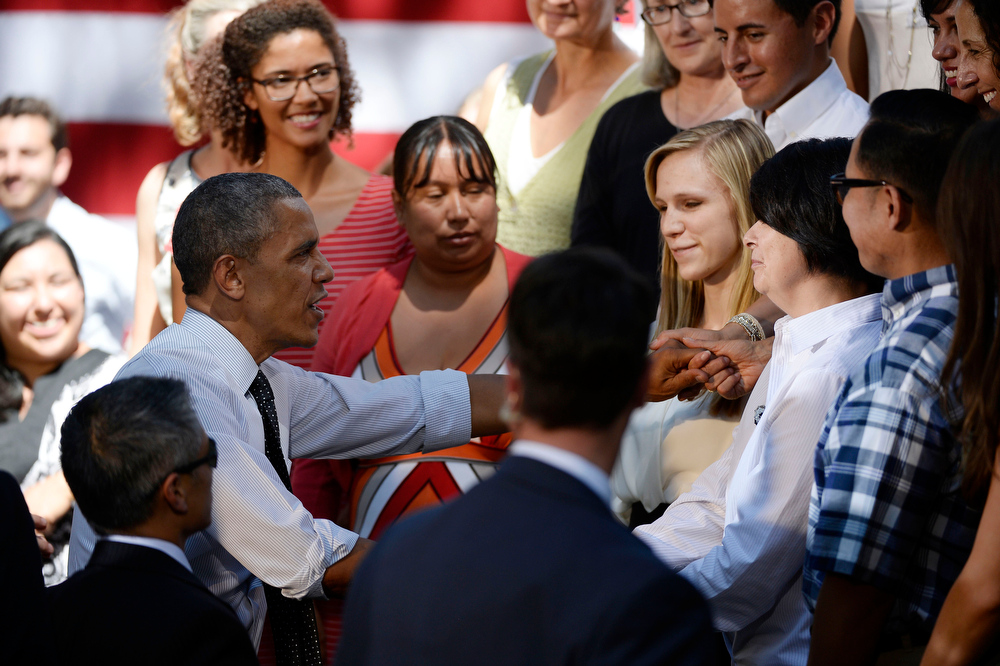. President Obama shakes hands wit guest after his speech to a crowd of hand-picked guests at Cheesman Park July 9, 2014 in Denver. Obama next headed to raise money for U.S. Sen. Mark Udall\'s re-election campaign at a private luncheon at the Westin Denver Downtown hotel. (Photo by John Leyba/The Denver Post)
